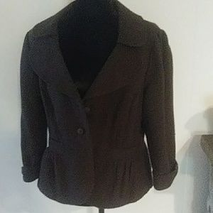 Brown fall lined blazer with tailored look.